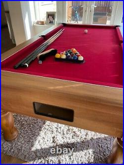 7ft pool table Immaculate condition red cloth. With all accessories. Oak finish
