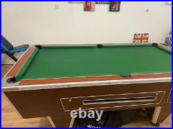 Used 7ft x 4ft fully functional with ball return. Comes with ACCESSORIES